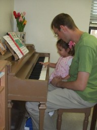 Derek and Karisa playing the piano